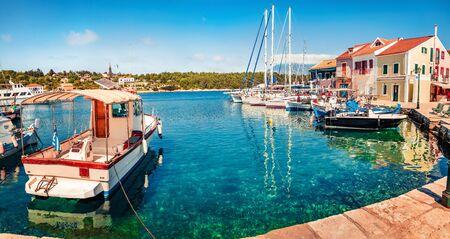 Romantic spring view of Fiskardo port. Marvelous morning seascape of Ionian Sea. Splendid outdoor scene of Kefalonia island, Greece, Europe. Traveling concept background.