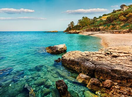 Picturesque spring view of Kanoni Beach. Marvelous evening seascape of Ionian Sea. Spectacular outdoor scene of Kassiopi village and resort, Corfu island, Greece, Europe. Beauty of nature concept background.