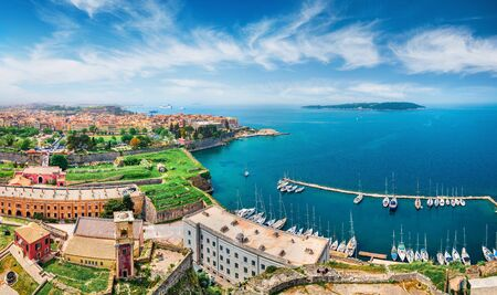 Aerial view of the capital of Corfu island. Splendid spring cityscape of Kerkira town. Bright morning seascape of Ionian Sea, Greece, Europe. Traveling concept background. Stock Photo