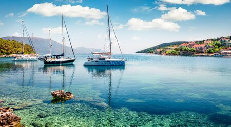 Captivating morning view of Fiskardo port. Picturesque spring seascape of Ionian Sea. Colorful morning scene of Kefalonia island, Greece, Europe. Traveling concept background.