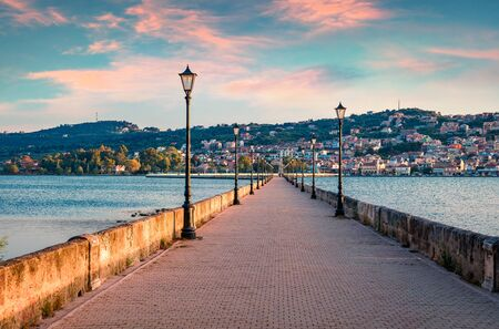 Attractive evening cityscape of Argostolion town, former municipality on the island of Kefalonia, Ionian Islands, Greece. Picturesque spring seascape of Ionian Sea. Traveling concept background. Stock Photo