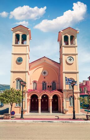 Picturesque morning view of Pantokrator Church. Bright spring cityscape of Lixouri town. Splendid outdoor scene of Kefalonia island. Architecture traveling background. Stock Photo