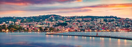 Panoramic evening cityscape of Argostolion town, former municipality on the island of Kefalonia, Ionian Islands, Greece. Dramatic spring seascape of Ionian Sea. Traveling concept background.