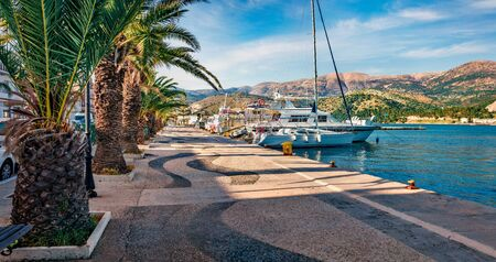 Picturesque spring cityscape of Argostoli port. Colorful morning scene of Kefalonia island, Greece, Europe. Beautiful seascape of Ionian Sea. Traveling concept background.
