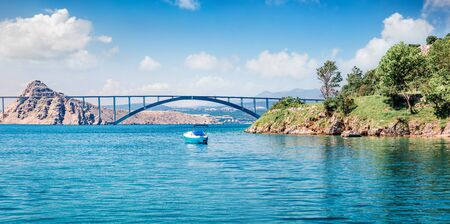 Colorful summer view of bridge to Krk island. Sunny morning scene of Croatia, Europe. Beautiful world of Mediterranean countries. Traveling concept background.