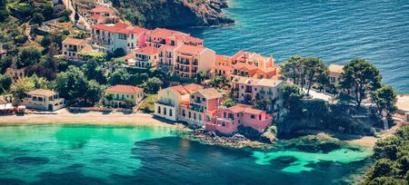 Aerial view of the Asos village from the Venetian Castle Ruins. Panoramic spring seascape of Ionian Sea. Picturesque outdoor scene of Kefalonia island, Greece, Europe. Traveling concept background. Stock Photo