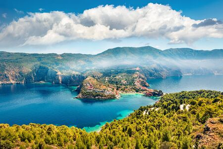 Aerial morning cityscape of Asos village on the west coast of the island of Cephalonia, Greece, Europe. Misty spring sescape of Ionian Sea. Traveling concept background. Stockfoto