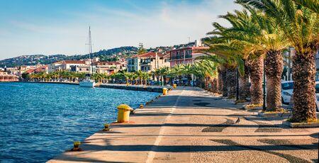 Panoramic spring cityscape of Argostoli port. Colorful morning scene of Kefalonia island, Greece, Europe. Beautiful seascape of Ionian Sea. Traveling concept background. Stock Photo