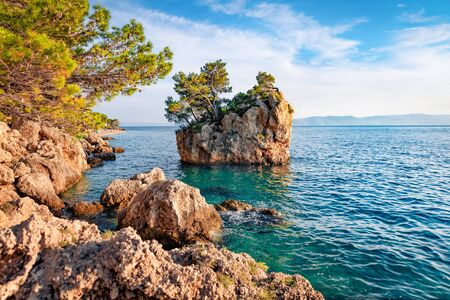 Sunny evening view of famous Brela stone. Captivating summer seascape of Adriatic sea, Dalmatian coast, Croatia, Europe. Beautiful world of Mediterranean countries. Beauty of nature concept background.