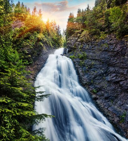 Fantastic morning view of Bride's Veil / Valul Miresei Waterfall. Captivating summer sunrise in Apuseni Natural Park, Cluj County, Romania, Europe. Beauty of nature concept background.