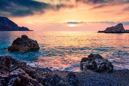 Dramatic spring view of Petani Beach. Spectacular sunset scene of Cephalonia Island, Greece, Europe. Unbelievable seascape of Mediterranen Sea. Mystical outdoor scene of Ionian Islands. Stock Photo