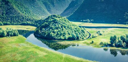 Aerial view of Canyon of Rijeka Crnojevica river, Skadar lake lacation. Impressive summer scene of Montenegro countryside. Beautiful world of Mediterranean countries. Beauty of nature concept background.