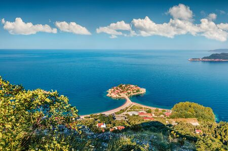 Aerial summer cityscape of Sveti Stefan town. Magnificent morning seascape of Adriatic sea, Montenegro, Europe. Beautiful world of Mediterranean countries. Traveling concept background.