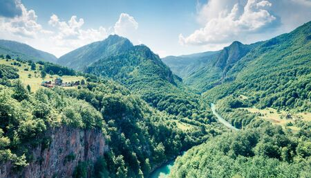 Bright morning view from Djurdjevica bridge over the river Tara. Splendid summer morning in Montenegro, Europe. Beautiful world of Mediterranean countries. Traveling concept background. 写真素材