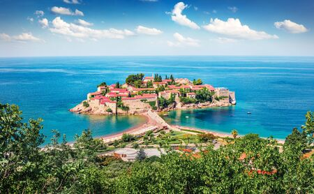Aerial summer cityscape of Sveti Stefan town. Picturesque morning seascape of Adriatic sea, Montenegro, Europe. Beautiful world of Mediterranean countries. Traveling concept background. Imagens