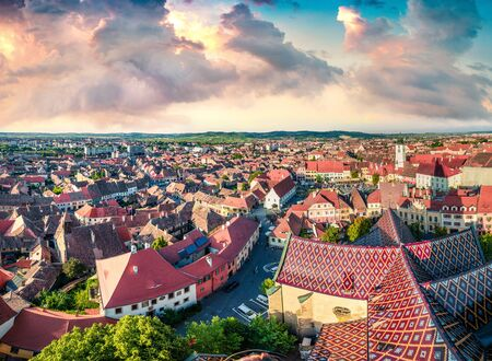 Aerial summer view of Tower of Council. Colorful cityscape of Sibiu town. Impressive sunset in Transylvania, Romania, Europe. Traveling concept background.