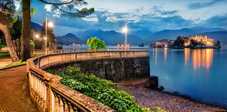 Great evening cityscape of Stresa town. Picturesque summer susnset on Maggiore lake with Bella island on background, Province of Verbano-Cusio-Ossola, Italy, Europe. Traveling concept background. Stockfoto