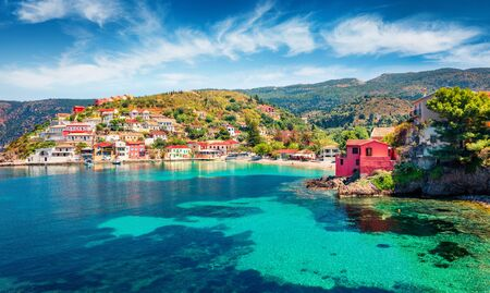 Colorful morning cityscape of Asos village on the west coast of the island of Cephalonia, Greece, Europe. Amazing spring sescape of Ionian Sea. Traveling concept background.