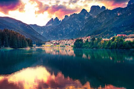 Dramatic sunset scene of Santa Caterina lake. Impressive summer view of Auronzo di Cadore / Aulus-les-Bains resort, Province of Belluno, Italy, Europe. Traveling concept background. Фото со стока