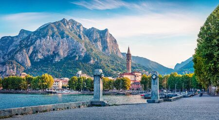 Picturesque summer scene of Como lake. Captivating morning cityscape of central park of Lecco town, Italy, Europe. Traveling concept background.