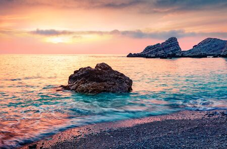 Spectacular spring view of Petani Beach. Impressive sunset scene of Cephalonia Island, Greece, Europe. Unbelievable seascape of Mediterranen Sea. Mystical outdoor scene of Ionian Islands.