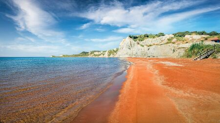 Picturesque spring landscape of famous Xi Beach. Colorful morning scene of Cephalonia island, Greece, Europe. Attractive seascape of Ionian Sea. Traveling concept background. Stock Photo