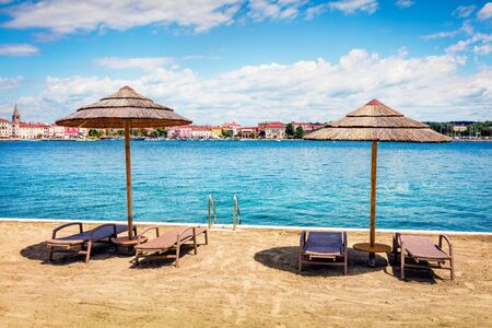 Sunny morning view of popular summer resort Porec. Colorful seascape of Adriatic Sea. Bright scene of Istrian Peninsula in western Croatia, Europe. Vacation concept background.