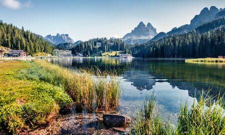 Sunny summer view of Misurina lake. Attractive morning scene of National Park Tre Cime di Lavaredo, Location Auronzo, Misurina resort, Dolomiti Alps, South Tyrol, Italy, Europe.