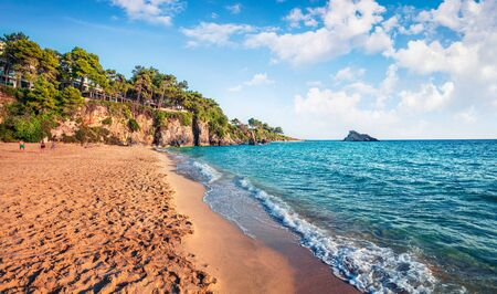 Attractive morning view of Platis Gialos Beach. Splendid summer seascape of Ionian Sea. Exciting outdoor scene of Kefalonia island, Argostolion town location, Greece, Europe. Traveling concept background.