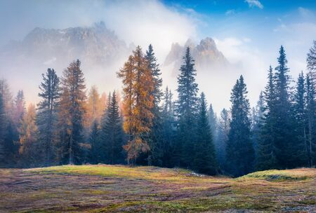 Foggy outdoor scene on Tre Chime Di Lavaredo National Park, Antorno lake location. Splendid autumn morning in Dolomiti Alps, Italy, Europe. Beauty of nature concept background.