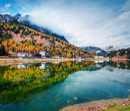Amazing morning scene on Misurina lake in National Park Tre Cime di Lavaredo. Colorful autumn landscape in Dolomite Alps, South Tyrol, Location Auronzo, Italy, Europe. Beauty of countryside concept background. Фото со стока