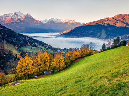 Wonderful view of Zell lake. Colorful autumn sunrise in Austrian town - Zell am See, south of the city of Salzburg. Beauty of nature concept background.