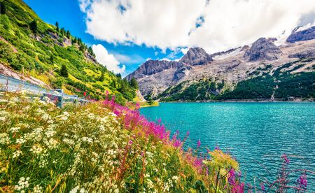 Wonderful morning view of Fedaia lake. Attractive summer scene of Dolomiti Alps, Gran Poz location, Trentino-Alto Adige/Sudtirol region, Italy, Europe. Beauty of nature concept background. Stok Fotoğraf