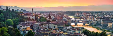 Panoramic evening cityscape of Florence, Italy, Europe. Beautiful medieval arched river bridges over Arno river.Traveling concept background.
