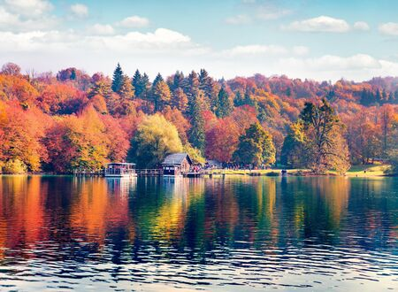 Excursion ships on the lake. Picturesque autumn view of Plitvice lake. Bright morning landscape of Croatia, Europe. Traveling concept background.
