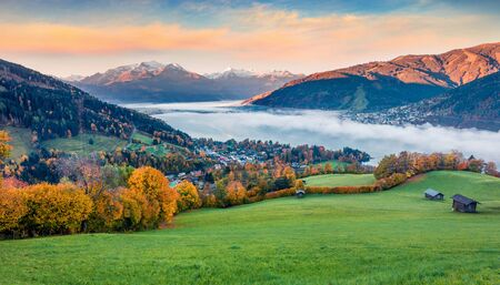 Fabulous view of Zell lake. Colorful autumn sunrise in Austrian town - Zell am See, south of the city of Salzburg. Beauty of nature concept background.