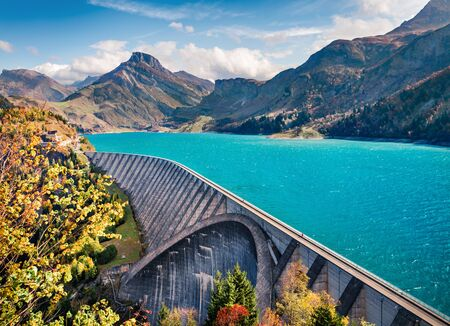Attractive autumn scene of Auvergne-Rhone-Alpes, France, Europe. Bright morning view of Roselend lake/Lac de Roselend. Beauty of nature concept background.