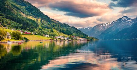 Splendid summer sunrise in Lofthus village in Ullensvang municipality which is located in the Hardanger region of Hordaland county, Norway. Beauty of countryside concept background. Reklamní fotografie