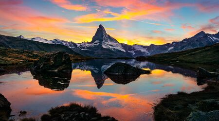 Exciting morning view of Stellisee lake with Matterhorn / Cervino peak on background. Unbelievable autumn scene of Swiss Alps, Zermatt resort location, Switzerland, Europe. Beauty of nature concept background.