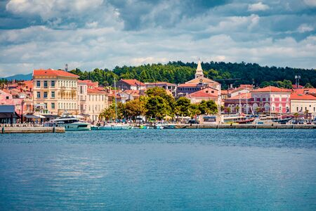 Colorful morning cityscape of popular summer resort Porec. Bright spring seascape of Adriatic Sea. Great  scene of Istrian Peninsula in western Croatia, Europe. Traveling concept background.  写真素材