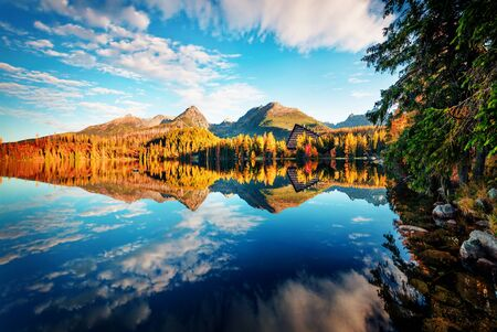 Wonderful autumn view of Strbske pleso lake. Romantic morning scene of High Tatras National Park, Slovakia, Europe. Beauty of nature concept background.