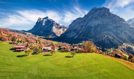 Picturesque autumn view of Grindelwald village valley from cableway. Wetterhorn and Wellhorn mountains, located west of Innertkirchen in the Bernese Oberland Alps. Switzerland, Europe.