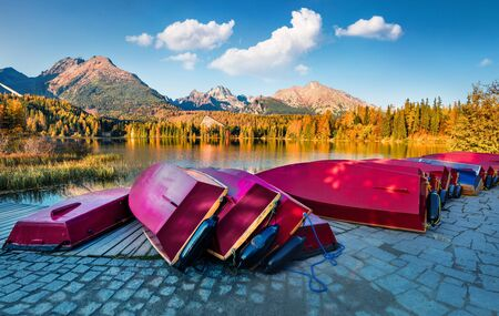 Colorful autumn view of Strbske pleso lake. Splendid evening scene of High Tatras National Park, Slovakia, Europe. Beauty of nature concept background.