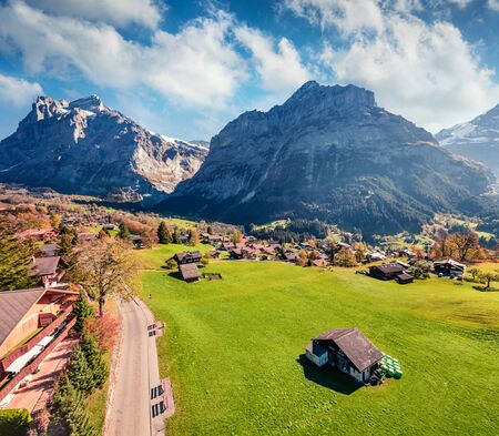 Splendid autumn view of Grindelwald village valley from cableway. Wetterhorn and Wellhorn mountains, located west of Innertkirchen in the Bernese Oberland Alps. Switzerland, Europe. Stock Photo