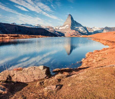 Amazing morning view of Stellisee lake with Matterhorn/Cervino peak on background. Attractive autumn scene of Swiss Alps, Zermatt resort location, Switzerland, Europe. Beauty of nature concept background.