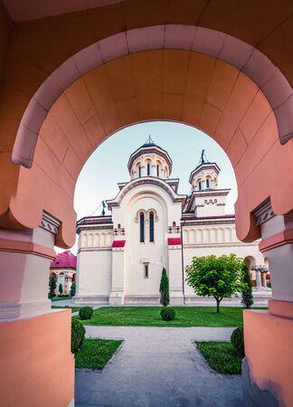 Marvelous summer view of Coronation Orthodox Cathedral in Fortress Of Alba Iulia. Picturesque evening scene of  Iulia Alba city, Transylvania, Romania, Europe. Traveling concept background.
