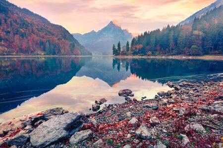 Fantastic autumn sunrise on Obersee lake, Nafels village location. Colorful morning scene of Swiss Alps, canton of Glarus in Switzerland, Europe. Beauty of nature concept background. Reklamní fotografie