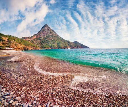 Picturesque summer seascape of Mediterranean sea. Sunny morning view of Adrasan beach with Moses Mountain on background, Turkey, Asia. Beauty of nature concept background. Archivio Fotografico