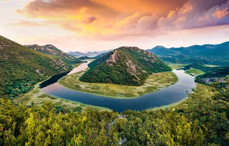 Incredible evening view of Canyon of Rijeka Crnojevica river, Skadar lake location. Fantastic summer sunset of Montenegro countryside. Beautiful world of Mediterranean countries.