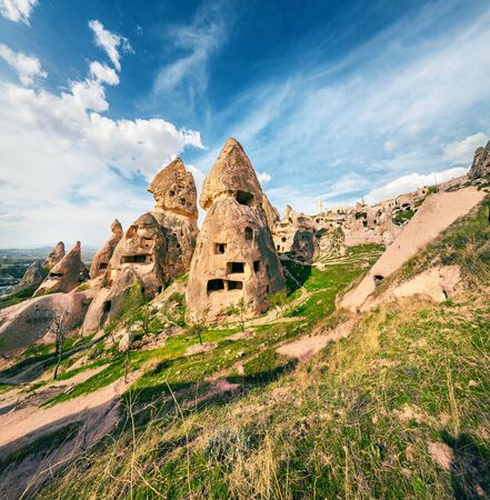 Fantastic world of Cappadocia. Stunning summer view of Uchisar Castle. Sunny morning scene of famous Uchisar village, district of Nevsehir Province in the Central Anatolia Region of Turkey, Asia.
